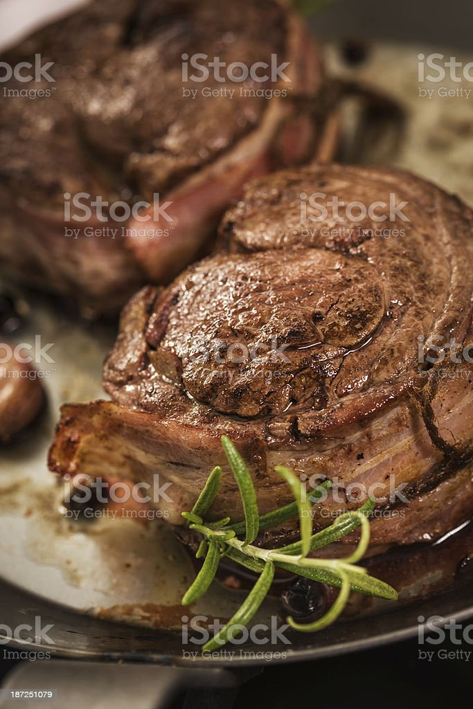 Filet Mignon with bacon, garlic and herbs royalty-free stock photo