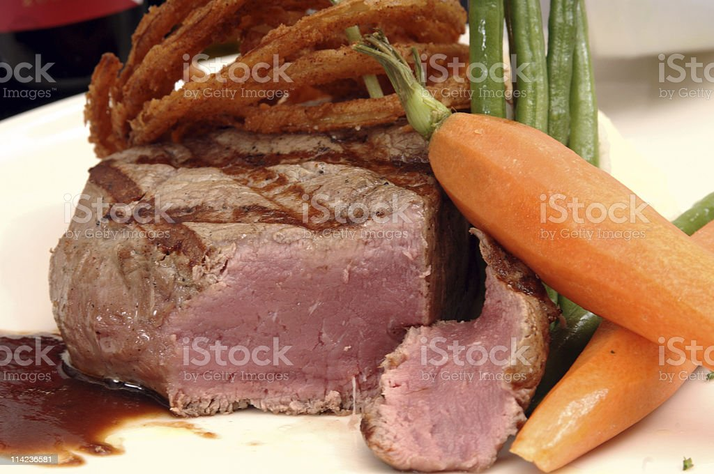 Filet mignon with carrots and onion rings royalty-free stock photo