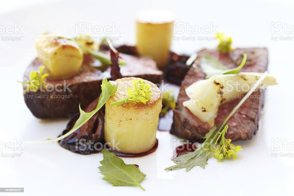 Filet mignon with potato fondant in port reduction royalty-free stock photo