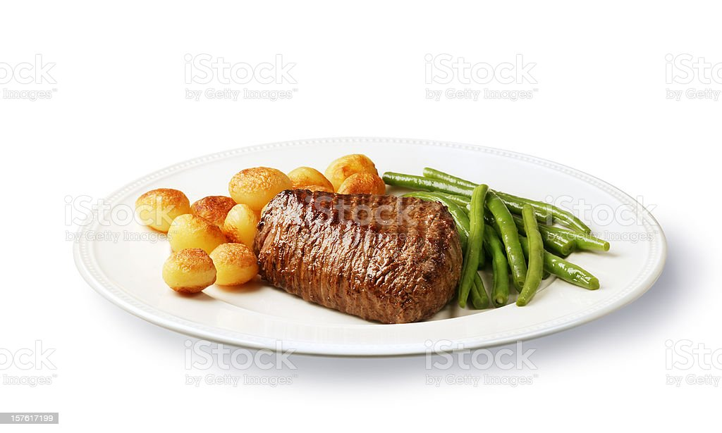 filet mignon with potatoes and green beans royalty-free stock photo