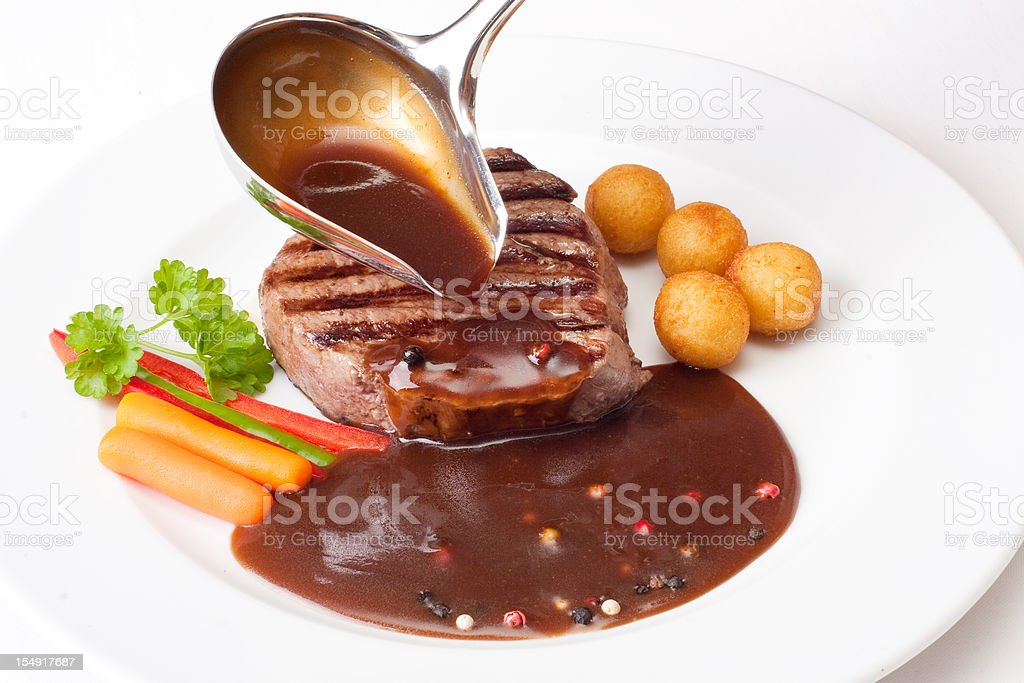 Filet mignon with sauce royalty-free stock photo