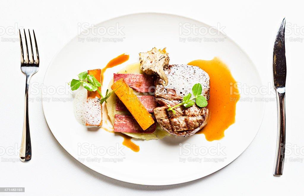 Filet mignon with smoked ox tongue, wild mushrooms and sauce stock photo
