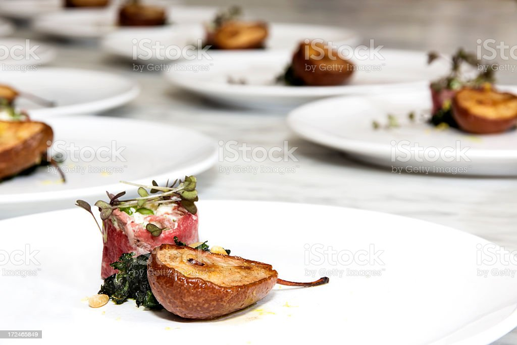 Filet Tartare with Roasted Pear stock photo