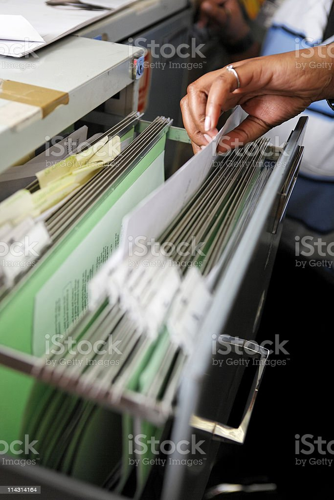 Filing hand royalty-free stock photo