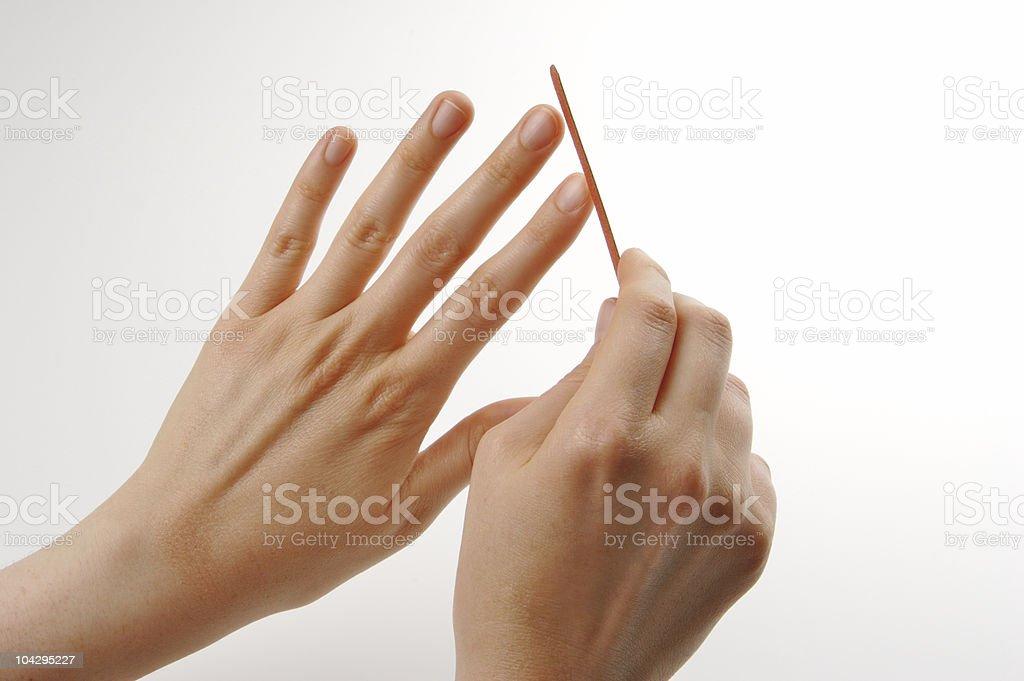 Filing nails royalty-free stock photo
