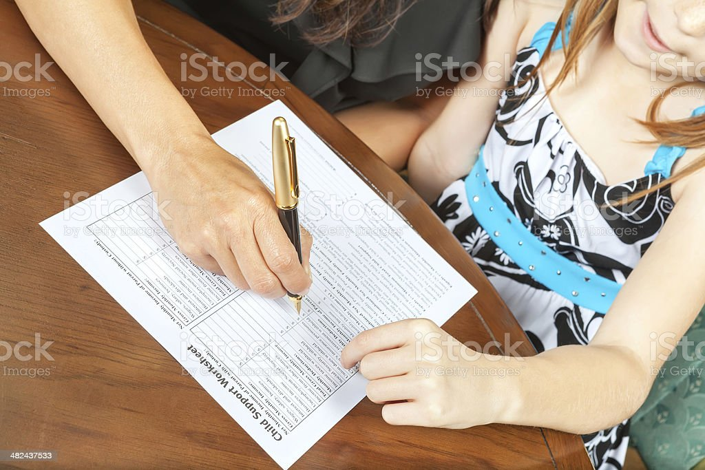 Filing out child support forms royalty-free stock photo