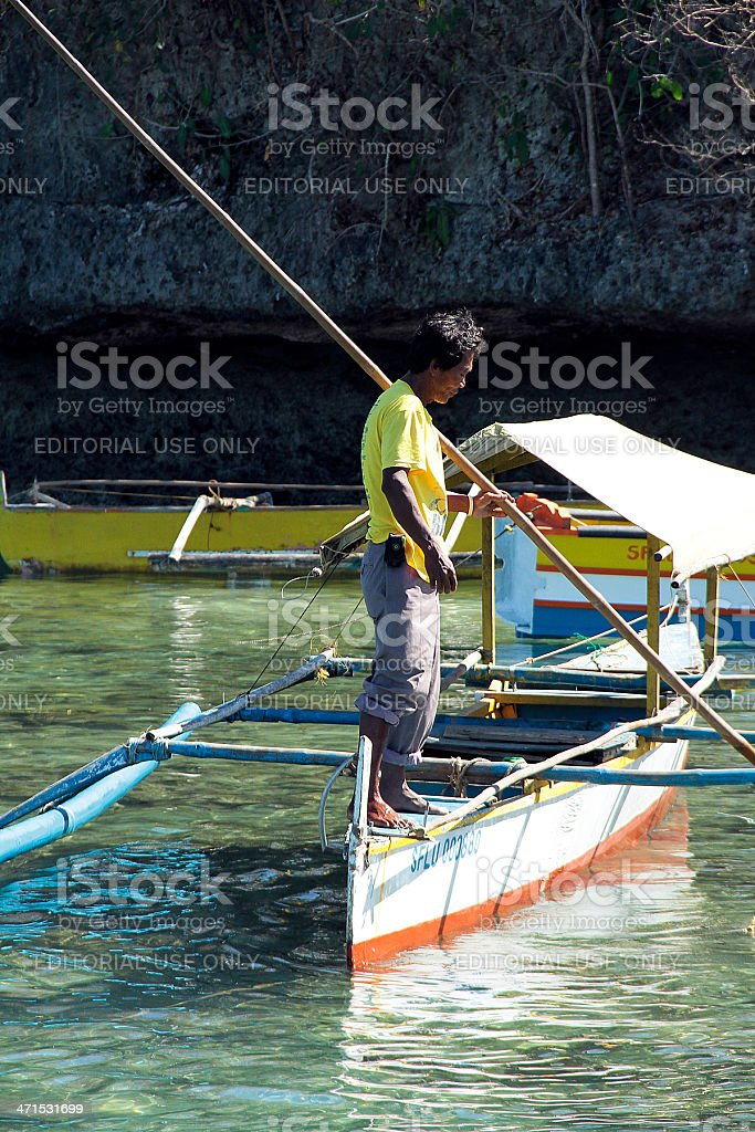 Filipino Boat Man holding a Piece of Bamboo royalty-free stock photo
