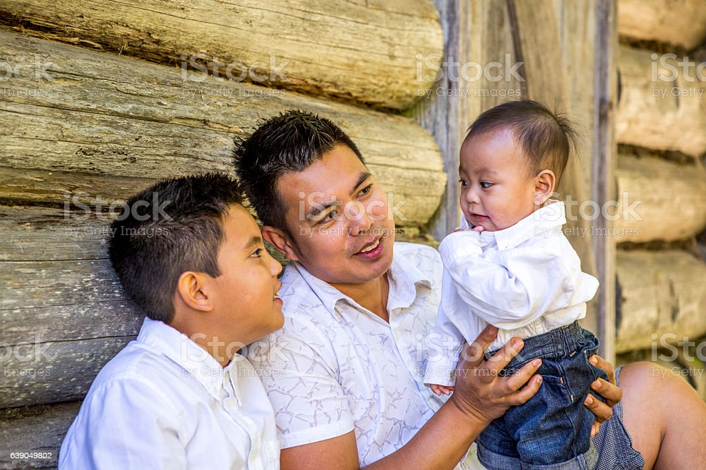 Filipino father with his two sons. stock photo