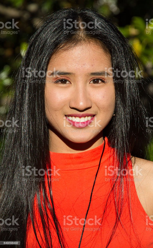 Filipino girl in a photo shoot in a city park. stock photo