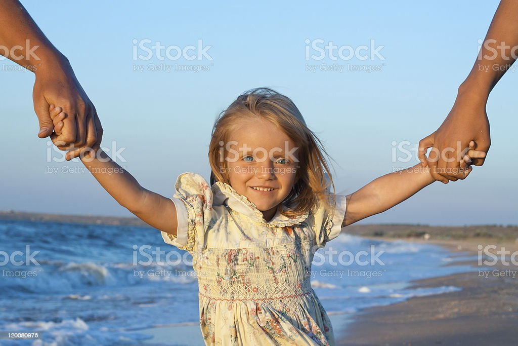 Fill confidence - Small girl on beach holding two hands royalty-free stock photo