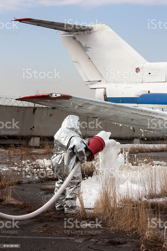Fill the plane with fire-fighting foam after emergency landing royalty-free stock photo