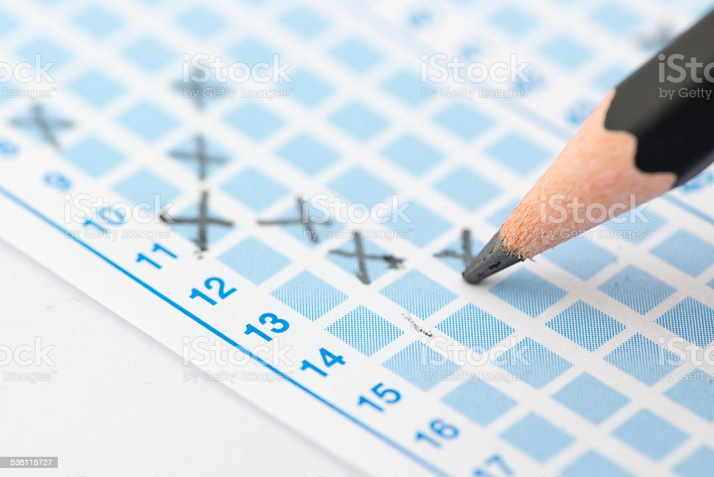 Filled answer sheet focus on pencil stock photo