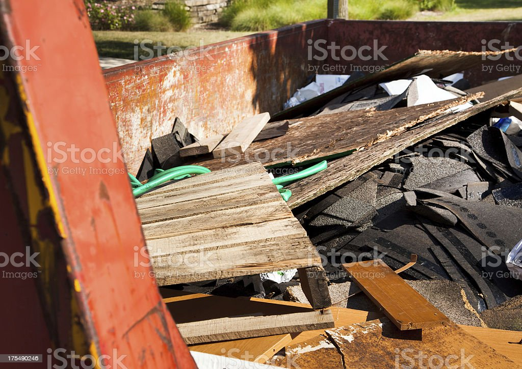 Filled construction garbage container royalty-free stock photo