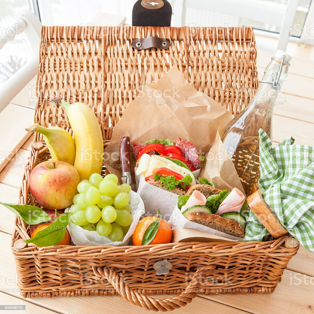 Filled picnic basket stock photo