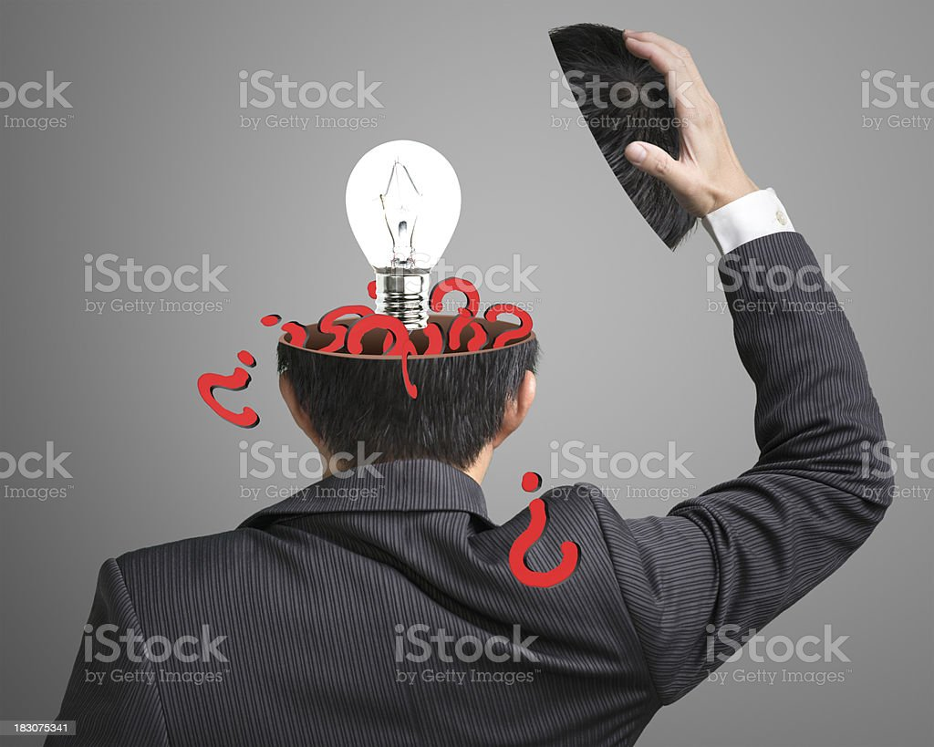 Filled question inside businessman head with lamp pop out stock photo