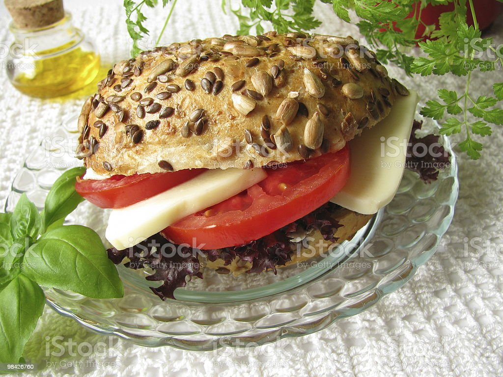 Filled roll with tomato and mozarella royalty-free stock photo