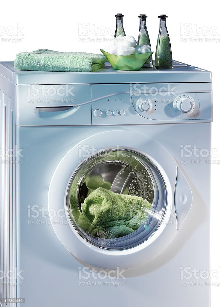 Filled washing machine (isolated with clipping path over white background) stock photo