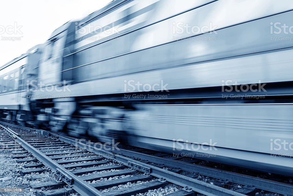 Filled with goods train, high-speed driving. stock photo