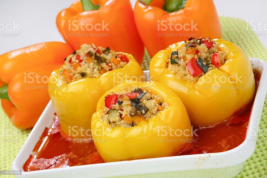 Filled yellow peppers with minced meat and rice royalty-free stock photo