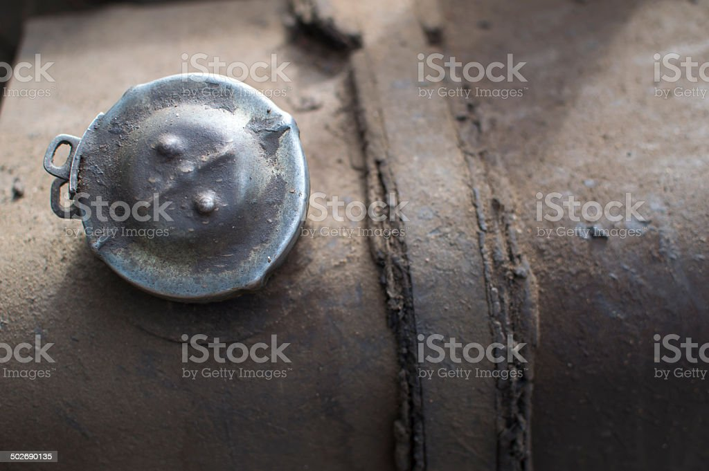 Filler cap in the tank of a truck royalty-free stock photo