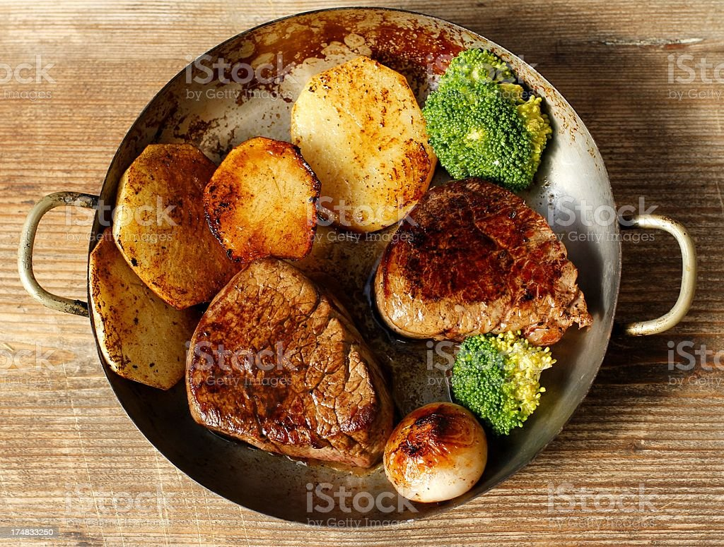 Fillet Mignon on the pan with broccoli and potato royalty-free stock photo