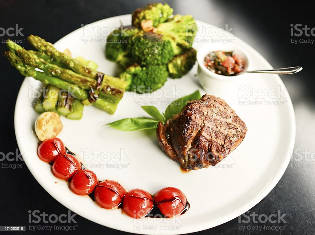 Fillet Mignon with Grilled Asparagus and Broccoli on a plate royalty-free stock photo