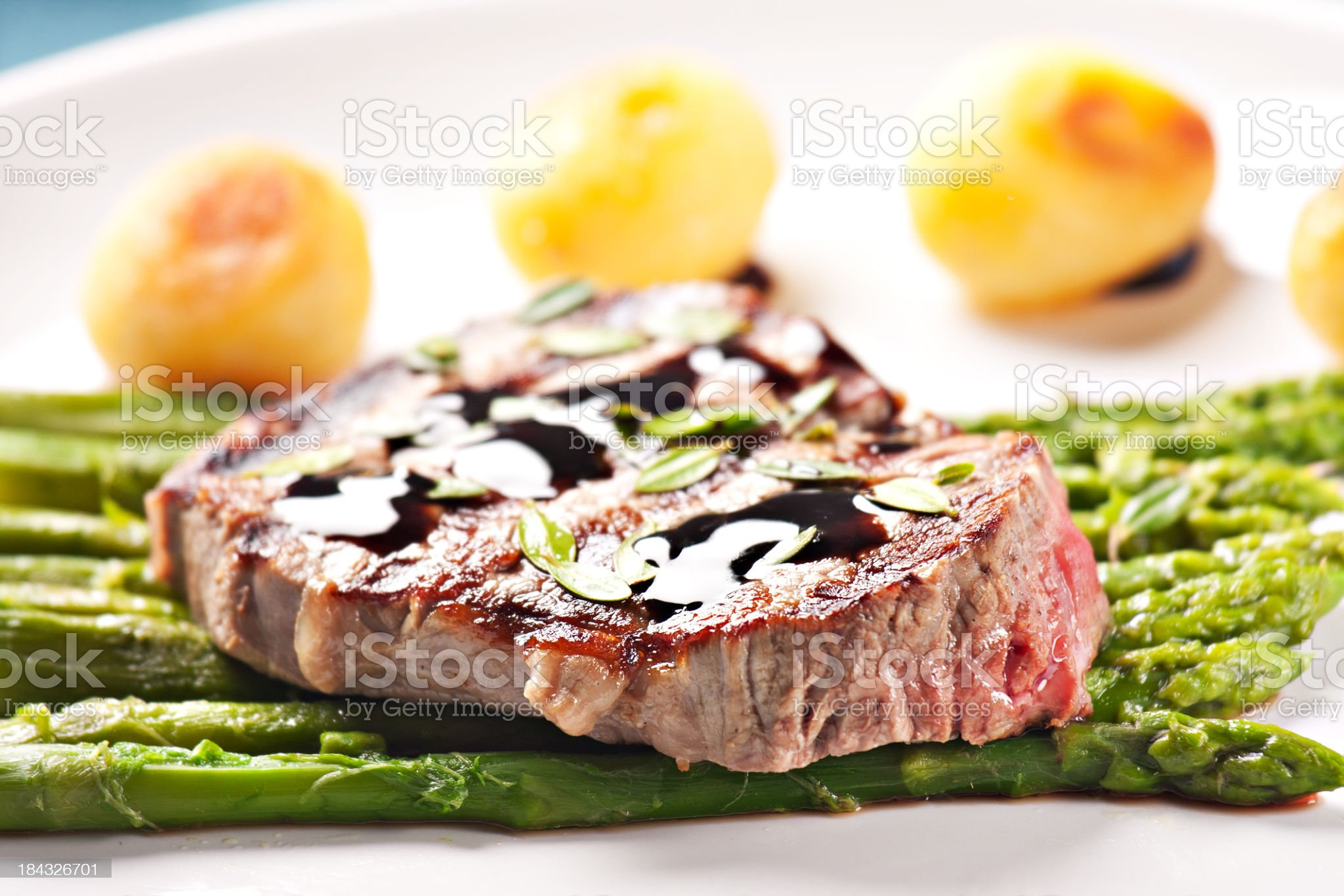 Fillet of beef with asparagus and potatoes royalty-free stock photo