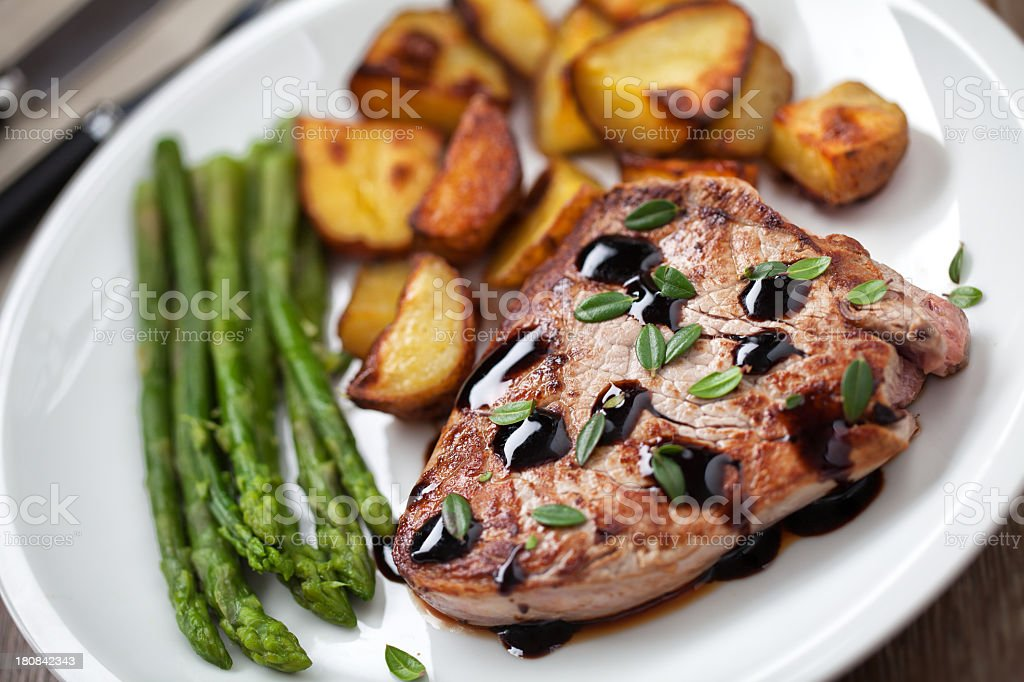 Fillet of beef with potatoes and asparagus royalty-free stock photo