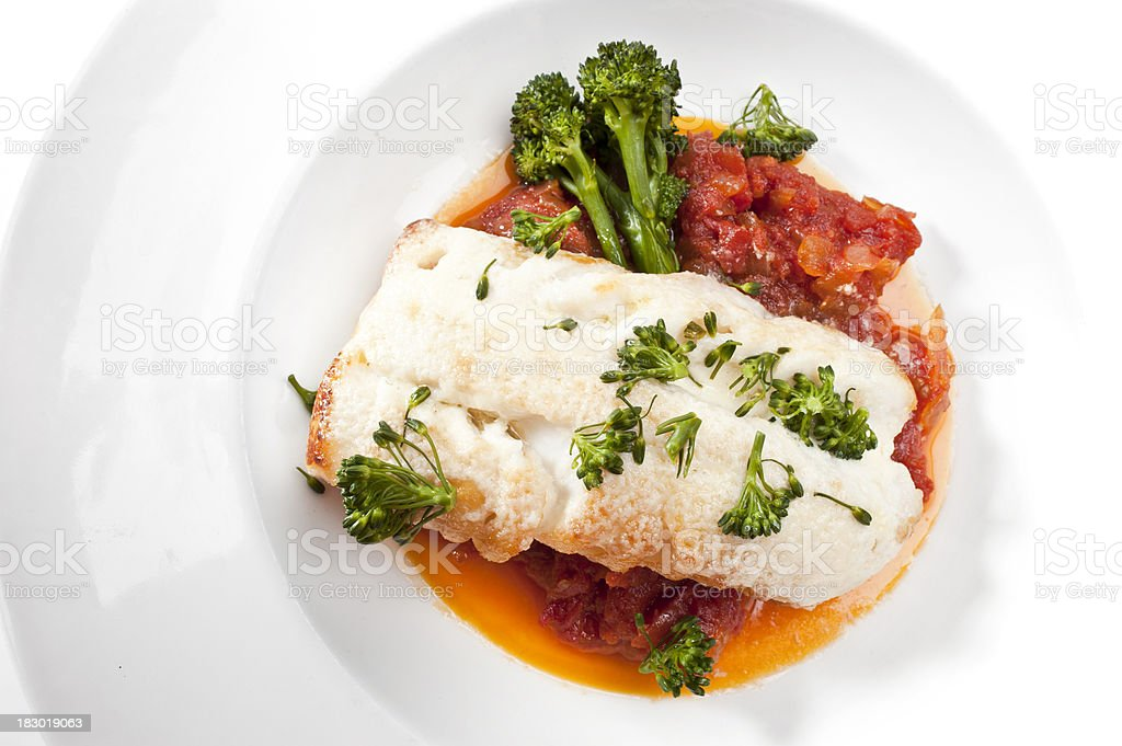 Fillet of cod fish in tomato sauce royalty-free stock photo