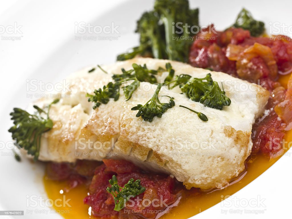 Fillet of cod fish with tomato sauce royalty-free stock photo