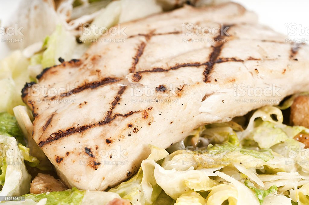 Fillet of fish Over Caesar Salad stock photo