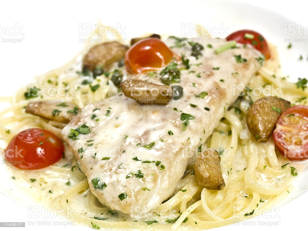 Fillet of fish over spaghetti alfredo royalty-free stock photo