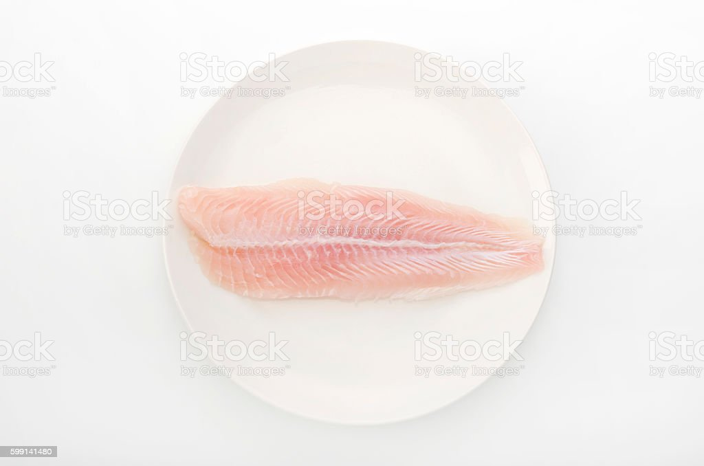 Fillet of Fish Pangasius. Isolated on white background. stock photo