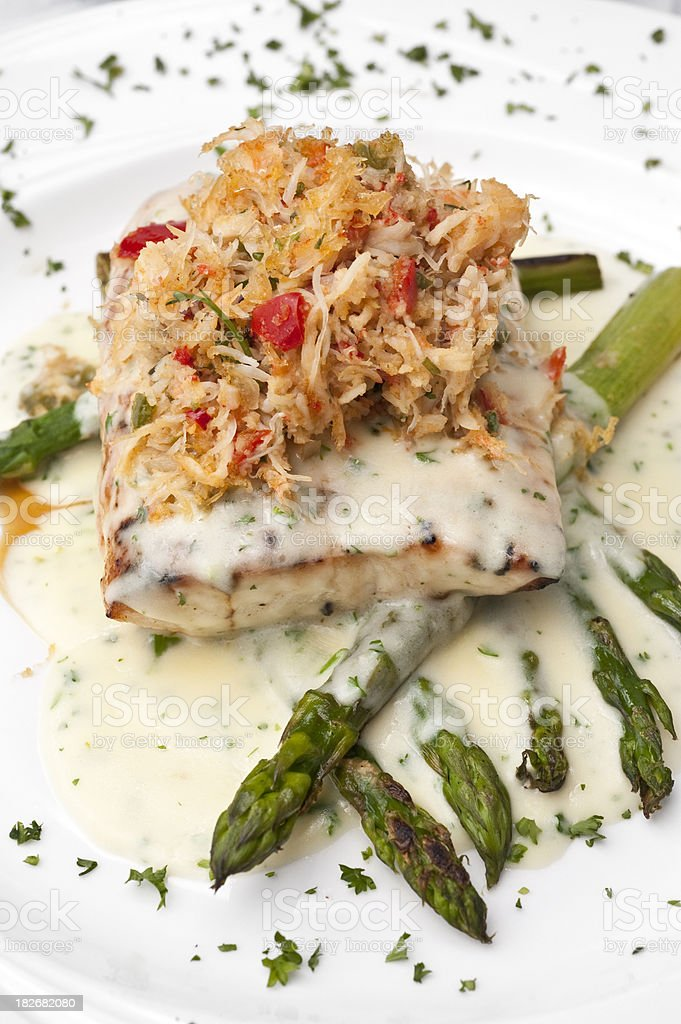 Fillet of Fish topped with shredded crab meat stock photo