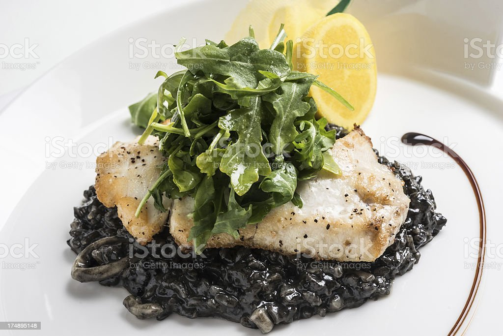 Fillet of Fish With Black Risotto royalty-free stock photo