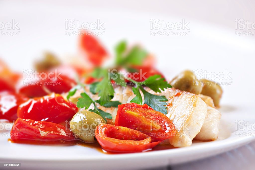 Fillet of halibut with tomatoes and olives royalty-free stock photo