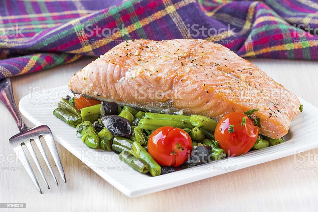 Fillet of red fish salmon with green beans, tomatoes, black stock photo
