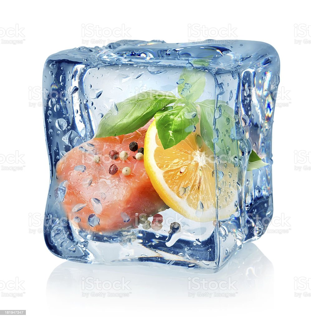 Fillet of salmon in ice cube stock photo