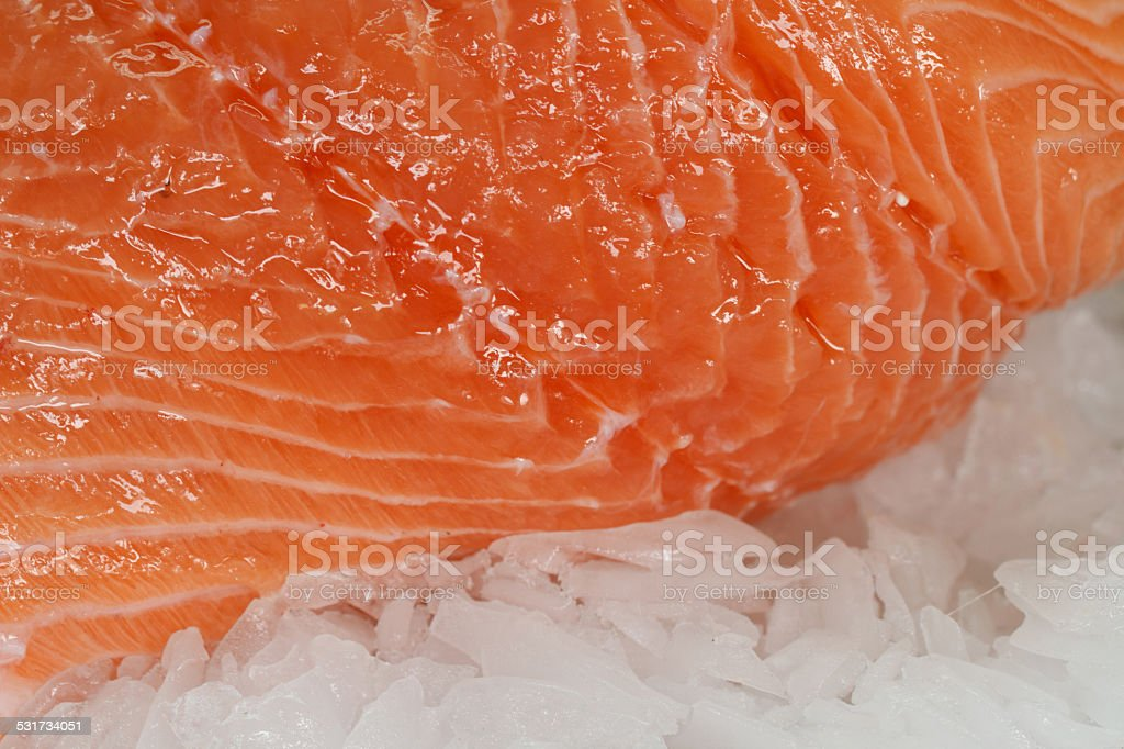 Fillet of salmon on ice close up. horizontal stock photo