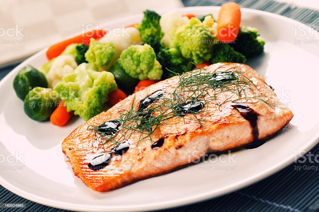 Fillet of salmon with mixed vegetables stock photo