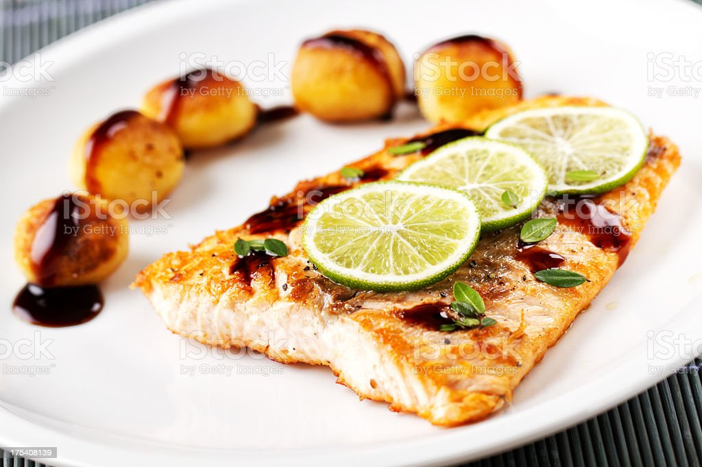 Fillet of salmon with potatoes royalty-free stock photo