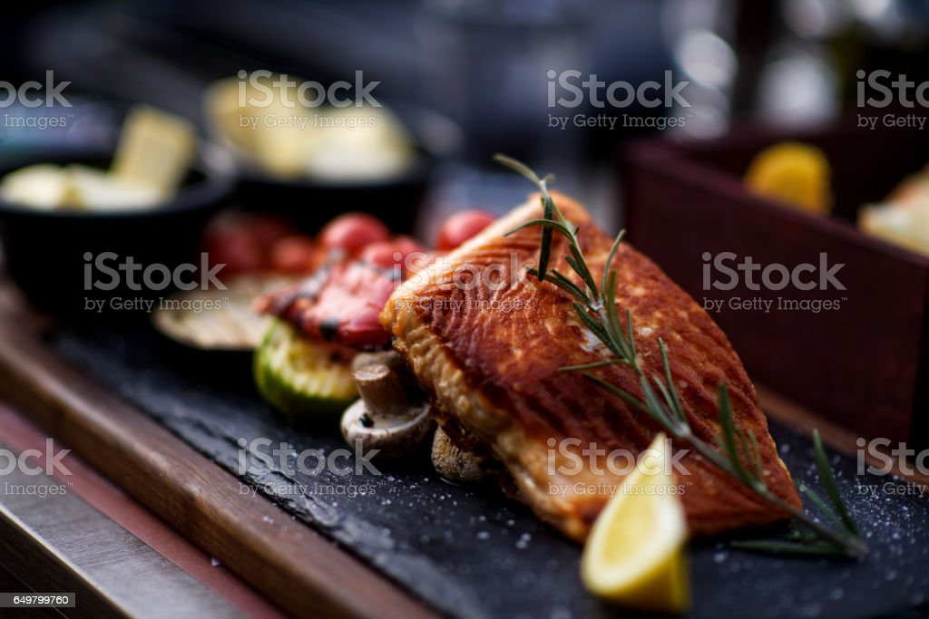 Fillet of salmon with vegetable stock photo