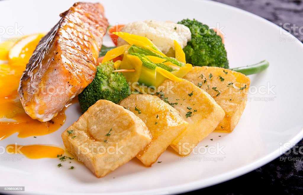 Fillet of white fish and vegetables stock photo