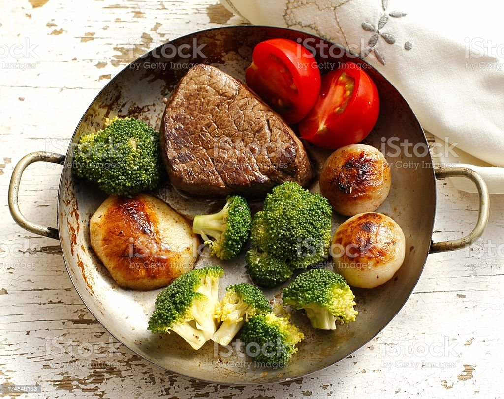 Fillet on the pan with broccoli and potato royalty-free stock photo