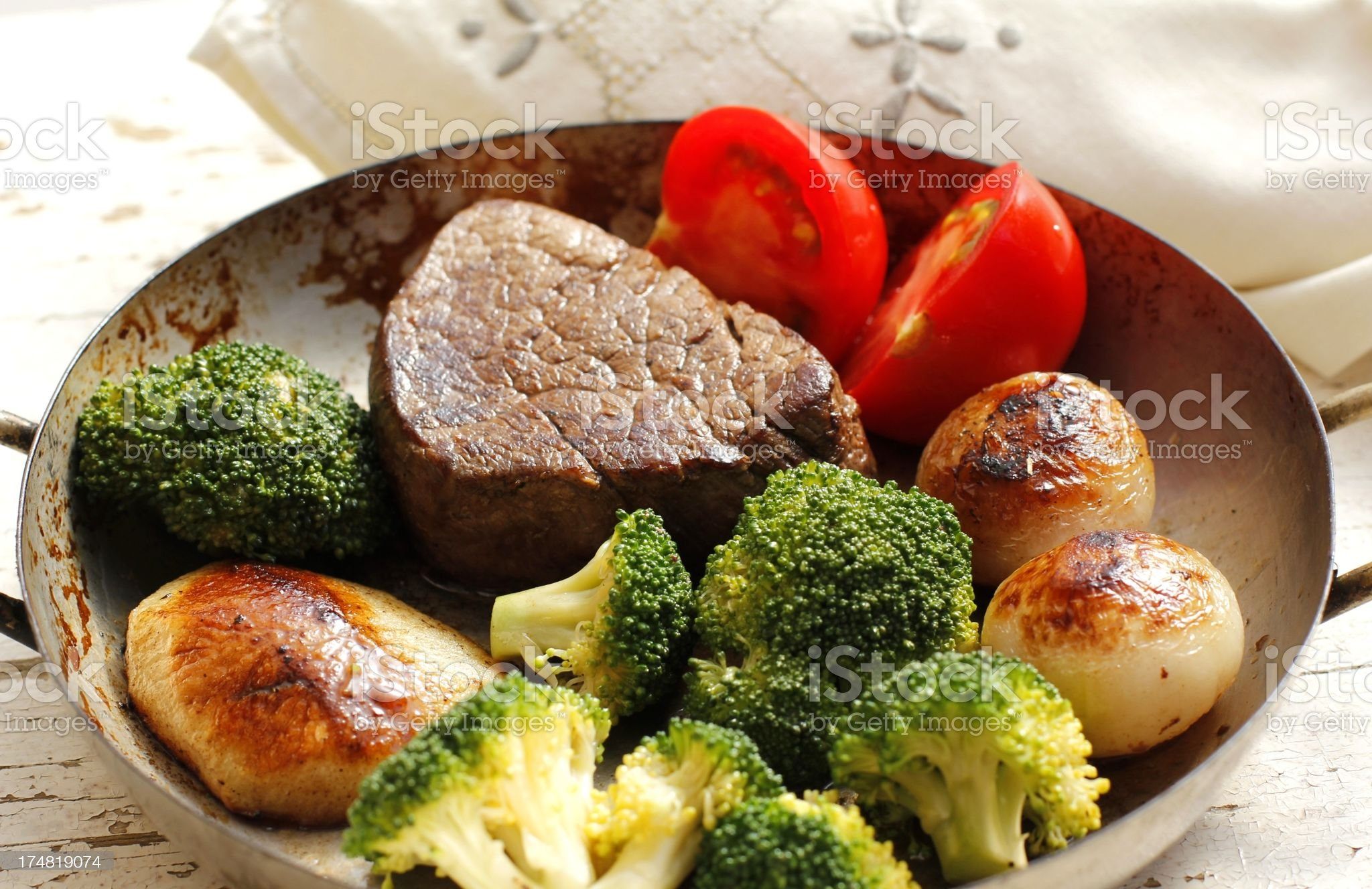 Fillet steak on the pan with broccoli and potato royalty-free stock photo