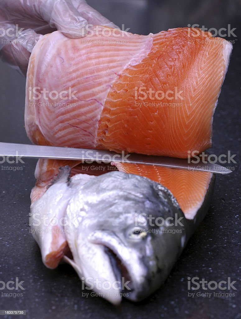 Filleting fresh salmon royalty-free stock photo