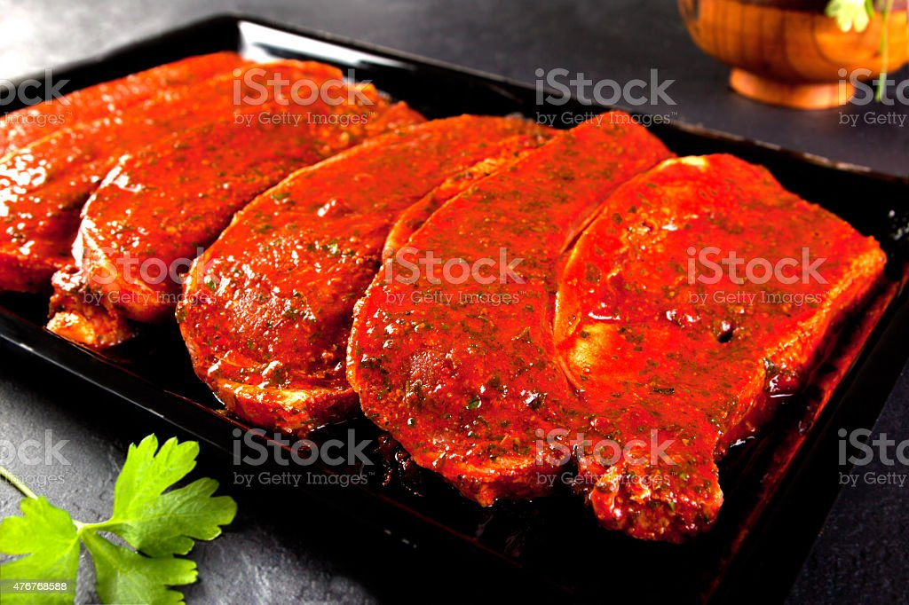 fillets marinated pork loin ready to cook. stock photo