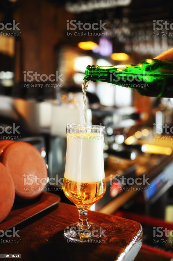 Filling a beer glass on the bar counter royalty-free stock photo