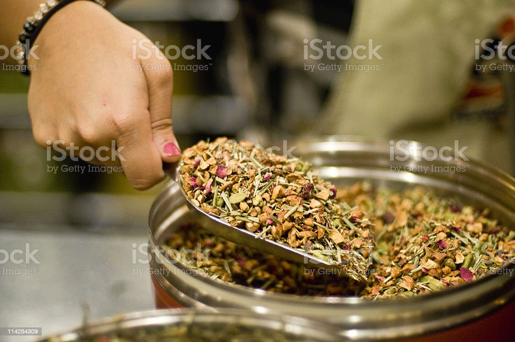 Filling a Can with herbal Teas royalty-free stock photo