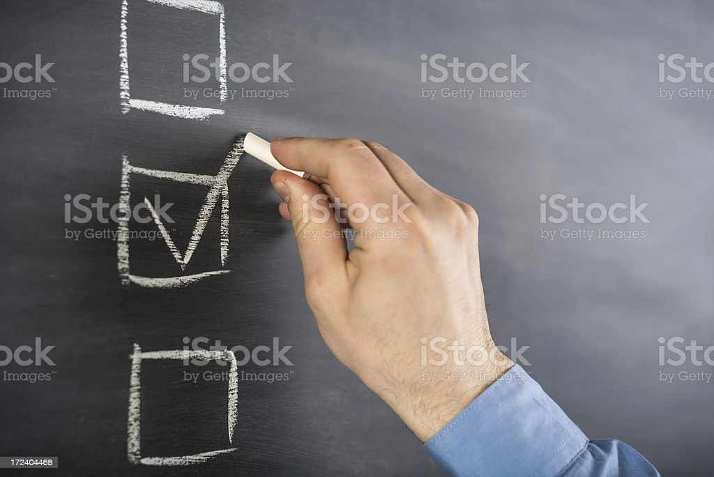 filling a checklist stock photo